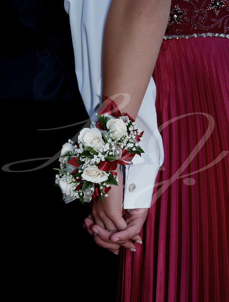 White Rose Wrist Corsage--White rose wrist corsage with red ribbon and babies breath.