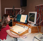 A DJ working at a radio station.---Contact Photographer for model release. lindasj2@hotmail.com